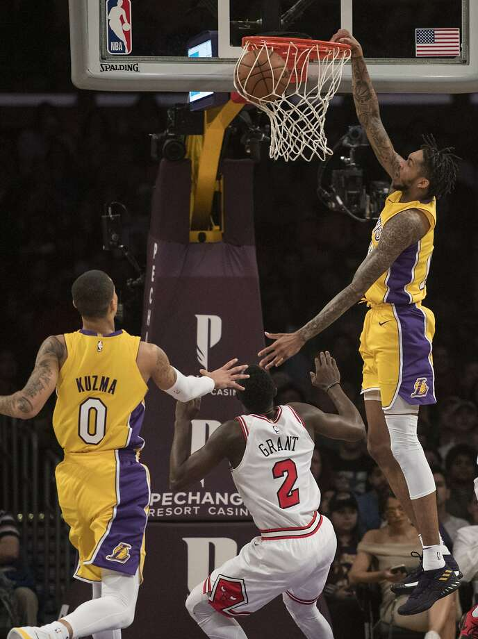 Lakers forward Brandon Ingram (right) soars to slam a dunk over Bulls guard Jerian Grant. Photo: Kyusung Gong, Associated Press