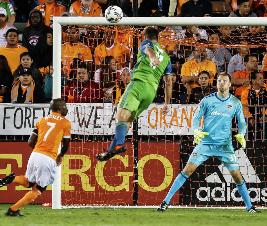 The Dynamo are burned by an old colleague as Will Bruin heads the ball past goalkeeper Joe Willis to give the Sounders a 2-0 lead in the 42nd minute Tuesday night. Photo: Brett Coomer, Staff / © 2017 Houston Chronicle