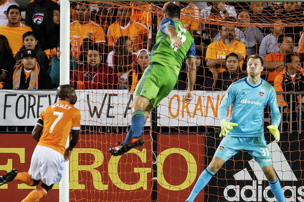 The Dynamo are burned by an old colleague as Will Bruin heads the ball past goalkeeper Joe Willis to give the Sounders a 2-0 lead in the 42nd minute Tuesday night.