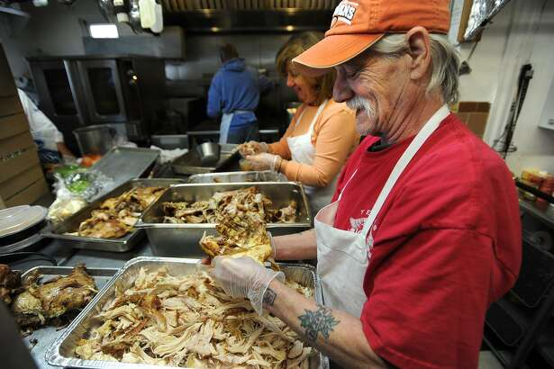 Volunteers prepare trays of turkey in November 2014 at Bridgeport Rescue Mission in Bridgeport, Conn.