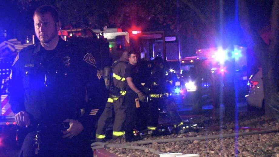 Paramedics tended to the firefighter at the scene of the fire in the 14600 block of Nacogdoches Road, and she is expected to be okay. Photo: Ken Branca