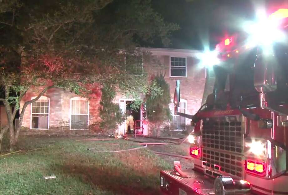 A northwest Houston home caught fire early Wednesday after officials said a cell phone charger ignited the bed on which it was sitting. Houston firefighters responded to a call for a house fire at Fallen Oaks Drive and Oak Trail Lane around 12 a.m. Wednesday. Photo: Metro Video LLC / For The Houston Chronicle
