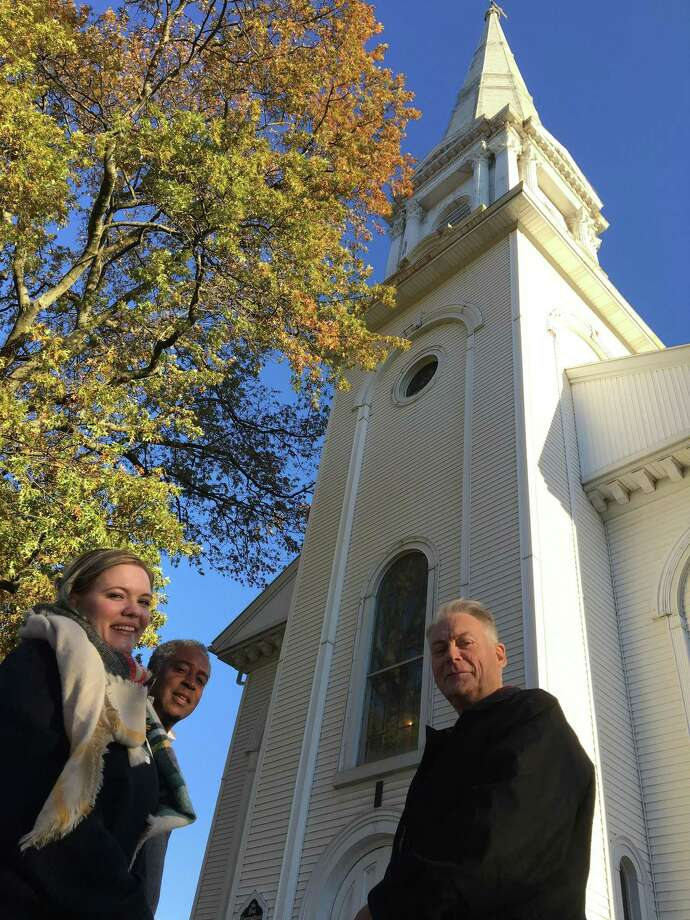 First Congregational Church of West Haven officials, from left, Director of Christian Education Jessica Tingley, Board of Trustees member John Lewis and Board of Trustees Chairman Mike Harrington, pose in front of the church on Friday, Nov. 17, 2017. The church has just finished installing a new electronic carillon system and will unveil it at West Haven's annual Christmas tree lighting ceremony on Saturday night, Nov. 25, and at an intergenerational community service at 10:30 a.m. Sunday, Nov. 26. Photo: Mark Zaretsky / Hearst Connecticut Media /
