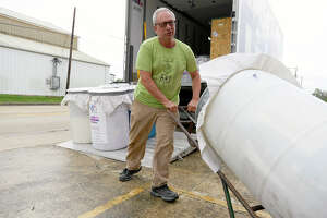 Greg Busceme unloads a barrel of art supplies collected by the Hildegard Center for the Arts in Nebraska on Tuesday. The supplies will be given to art teachers whose classrooms and supplies were damaged by Tropical Storm Harvey.  Photo taken Tuesday 11/21/17 Ryan Pelham/The Enterprise