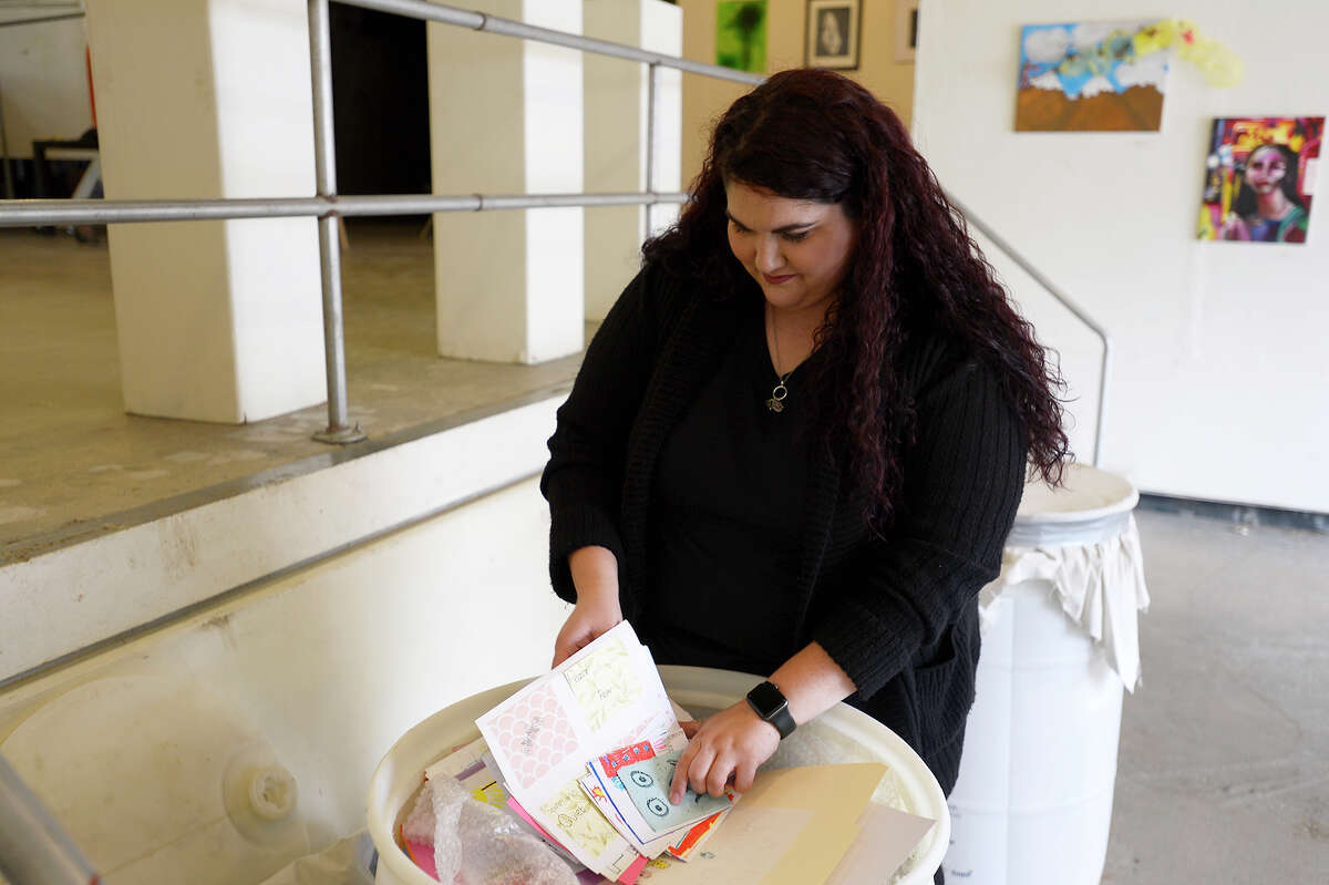 Kelsey Thibodeaux looks through cards made by children included in art supplies collected by the Hildegard Center for the Arts in Nebraska on Tuesday. The supplies will be given to art teachers whose classrooms and supplies were damaged by Tropical Storm Harvey. Photo taken Tuesday 11/21/17 Ryan Pelham/The Enterprise