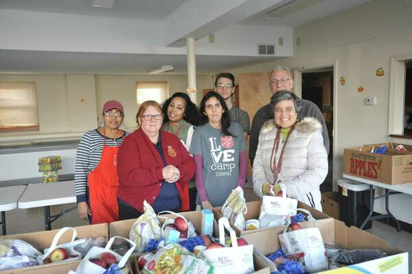 The Salvation Army church on Oak Avenue in Torrington distributed baskets of food for the Thanksgiving holiday Tuesday. Above, volunteers in attendance, including Major. Tina Streck, Leira Amador, Evelyn Luciano, McKenzie Robbs, Frank Morrell, and Rena Fitzgerald.