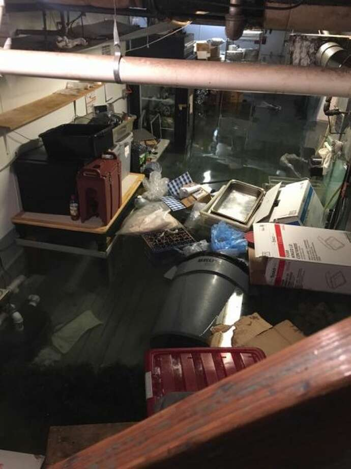 The Illium Café in Troy was severely damaged by a flood from a burst sprinkler pipe, with water inside reaching up to 4 feet,