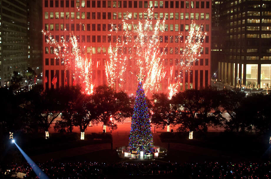 fireworks explode over the christmas tree during the annual mayors holiday celebration and tree lighting at
