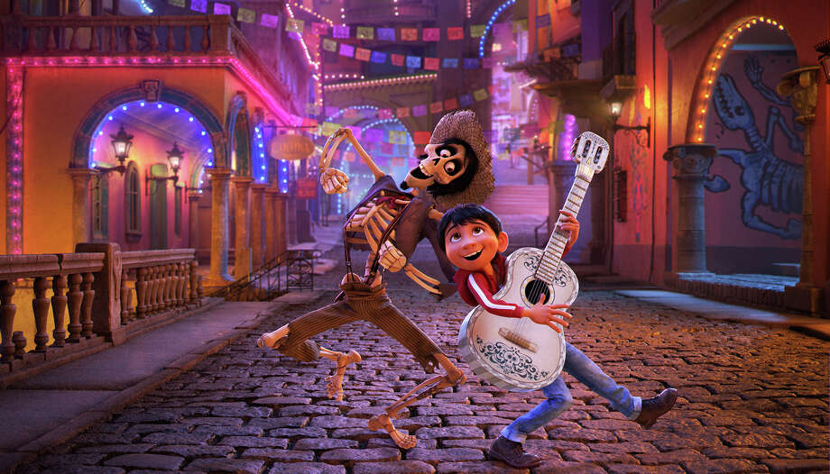 """""""Coco""""The latest animated Pixar release follows the adventures of Miguel, a singer who finds himself in the mysterious Land of the Dead. Opened Wednesday.Wide release. / © 2017 Disney•Pixar. All Rights Reserved."""