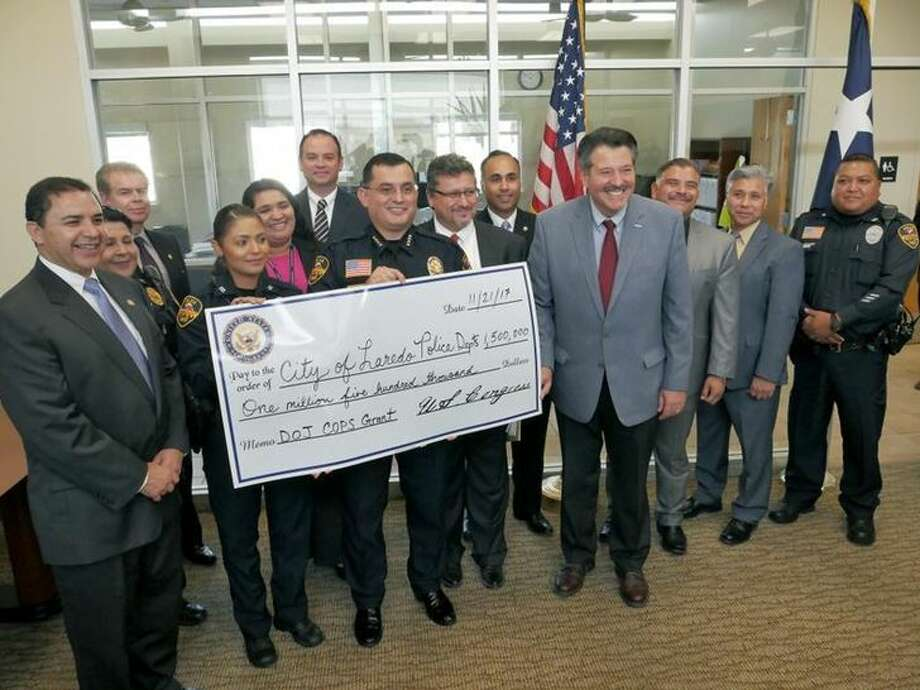 Congressman Henry Cuellar and City of Laredo and LPD officials participated in a news conference at El Portal on Tuesday to announce a $1.5 million Department of Justice COPS Grant that LPD received. The funds will be used to hire 12 police officers in 2018. Photo: Cuate Santos/Laredo Morning Times