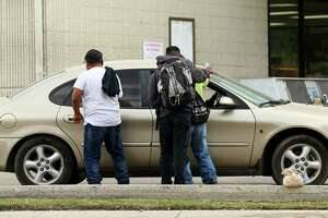 Day laborers approach a vehicle for potential work at a gas station Tuesday, Nov. 21, 2017, in Houston. ( Godofredo A. Vasquez / Houston Chronicle )