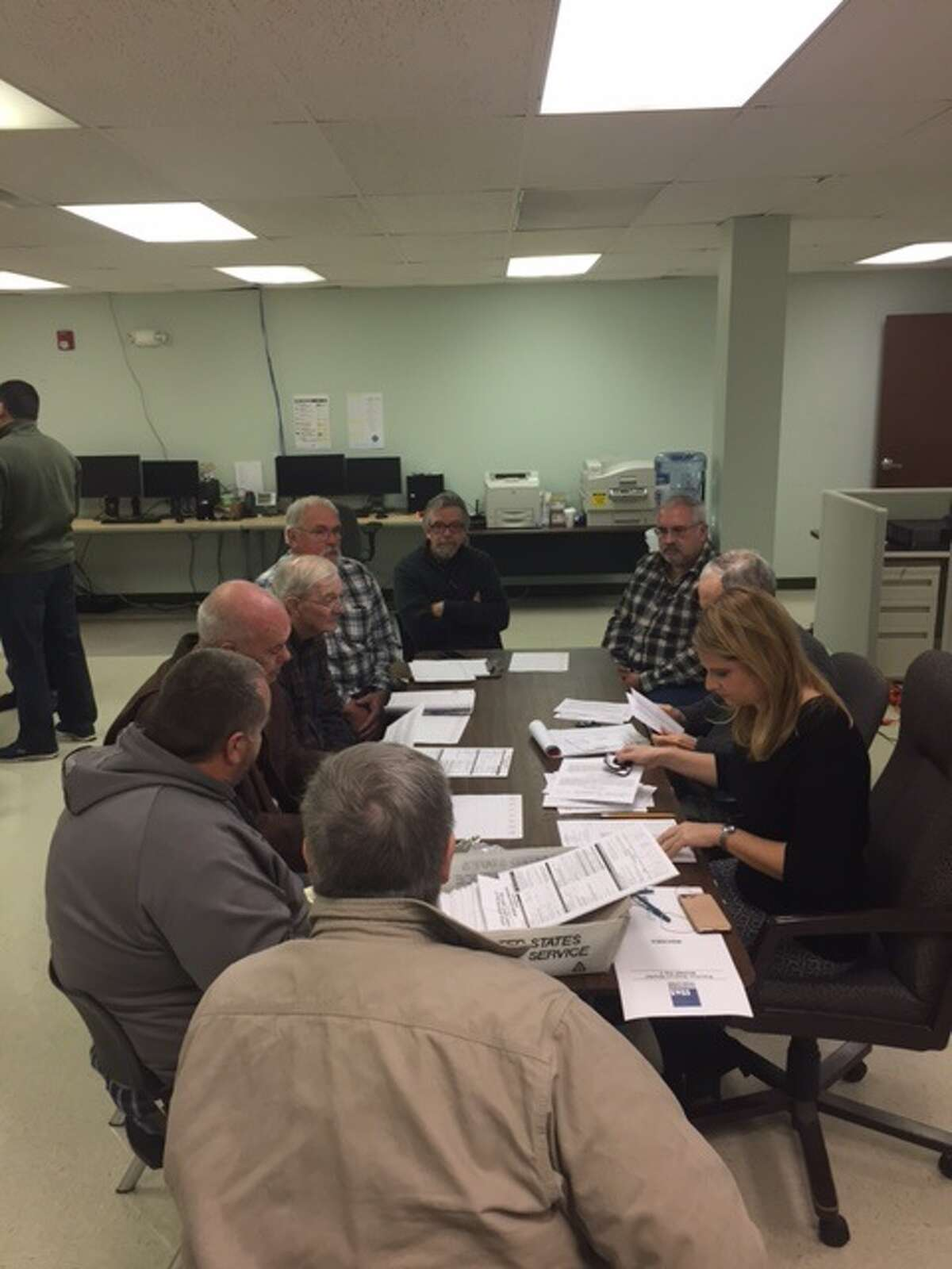 Absentee ballots are counted for Town of Berne races at the Albany County Board of Elections on Wednesday, Nov. 15, 2017 in Albany.