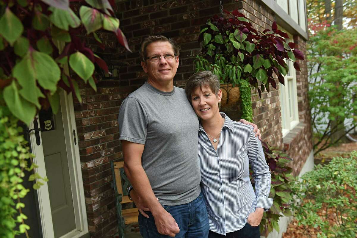 Meg Keyes and her husband Joe Scufca stand outside their home on Tuesday, Oct 31, 2017 in Niskayuna, N.Y. Meg is suing her former employer, Goldman Sachs, for discriminating against her after she was diagnosed with breast cancer. (Lori Van Buren / Times Union)