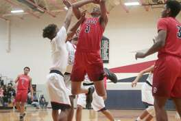 Dawson's Kris Dixon makes a power move inside Tuesday against Manvel in a non-disrtrict boys' basketball game.