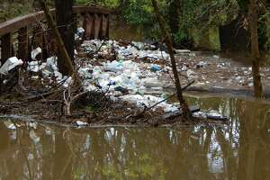 Photos from February 2017 show a buildup of trash in the Olmos Creek area.