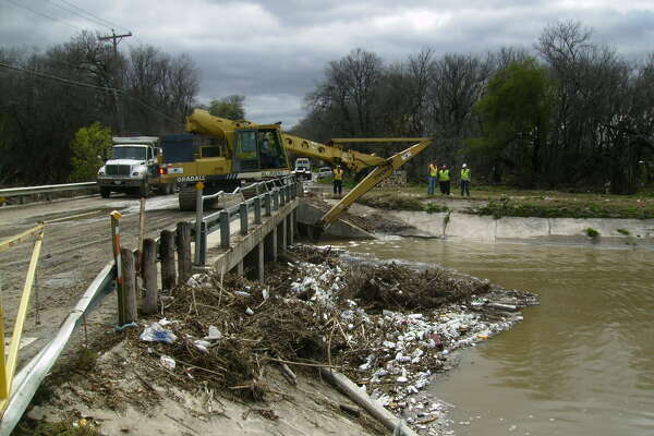 Photos from January 2006 show a buildup of trash in the Olmos Creek area.