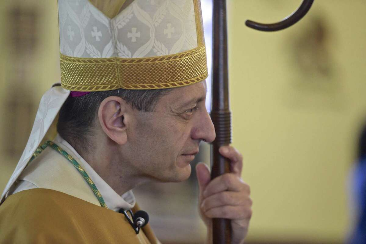 Bishop Frank Caggiano celebrates Mass at St. Rose of Lima Church in Newtown Monday.