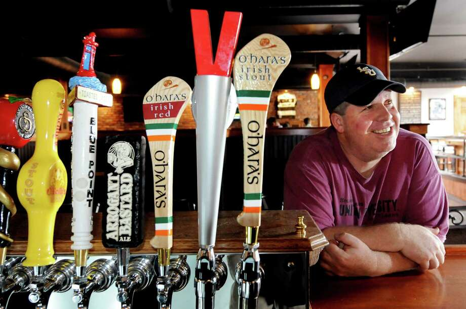 Mike Graney stands at the bar by the beer taps at his new tavern called Stout on Tuesday, May 24, 2011, in Albany, N.Y. (Cindy Schultz / Times Union) Photo: Cindy Schultz / 00013243A