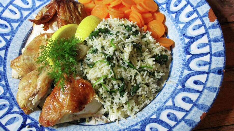 This photo shows a Greek-style rice pilaf served with chicken in New York. This dish is from a recipe by Sara Moulton. (Sara Moulton via AP) ORG XMIT: NYSM101 Photo: Sara Moulton / Sara Moulton