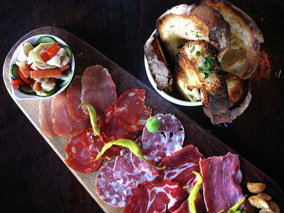Charcuterie board with salumi, pickled vegetables and grilled bread from Barbaro. Photo: Mike Sutter /San Antonio Express-News