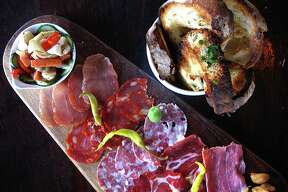Charcuterie board with salumi, pickled vegetables and grilled bread from Barbaro.