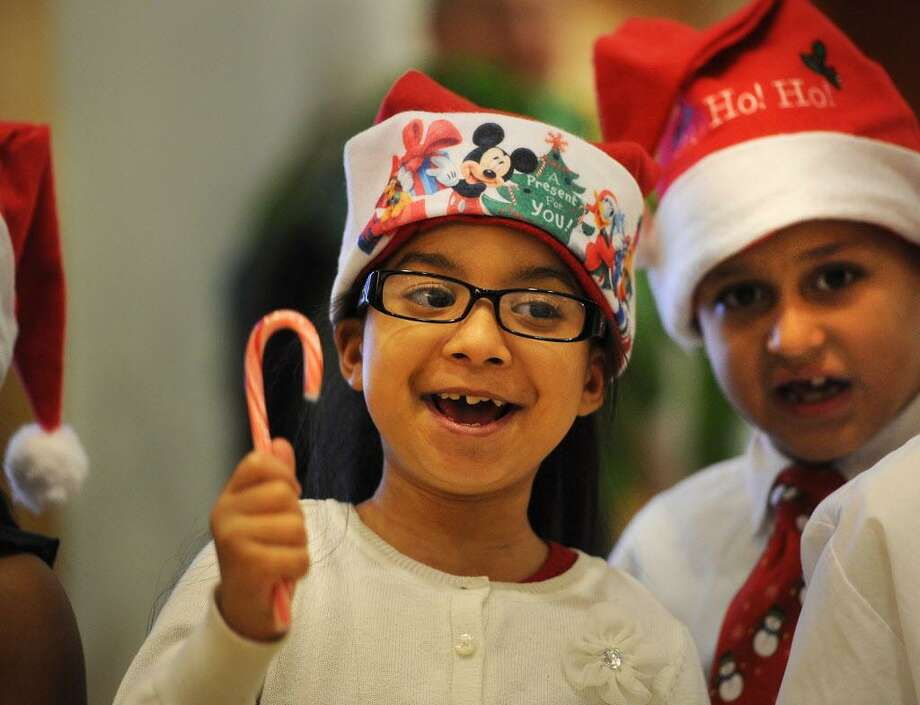 Wilbur Cross School second graders Kayla Dipres, left, Eliezer Ortiz, and their classmates recite Christmas poems during the 12th Annual Christmas Tree Lighting ceremony at St. Vincent's Medical Center in Bridgeport, Conn. on Monday, December 1, 2014. Photo: Brian A. Pounds / Brian A. Pounds / Connecticut Post