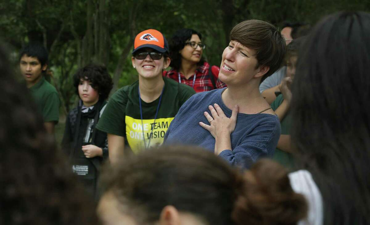 Joey Fauerso, a Texas State University art professor who has been commissioned to paint a mural near Cotton Academy, listens to fourth- and seventh-graders' reflections on nature after a field trip to Guadalupe River State Park on Nov. 2, 2017.