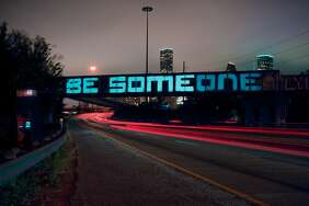 "Alex Ramos and Billy Baccam, of Houston's Input/Output digital creative lab, have transformed the city's ""BE SOMEONE"" graffiti into a beautiful art piece in celebration of the ongoing mural festival HUE."