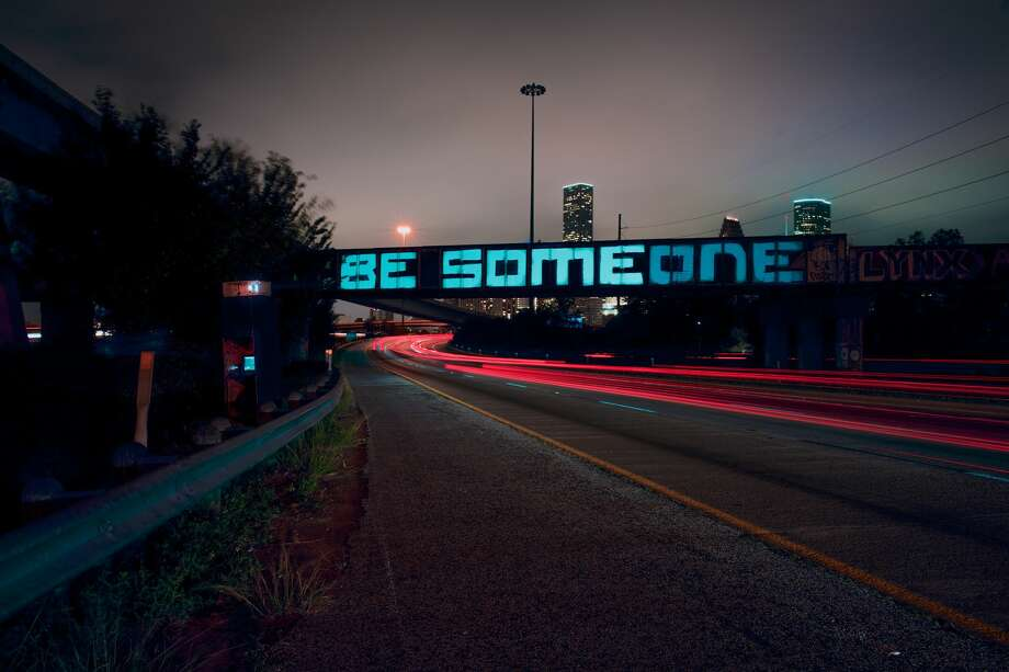 """Alex Ramos and Billy Baccam, of Houston's Input/Output digital creative lab, have transformed the city's """"BE SOMEONE"""" graffiti into a beautiful art piece in celebration of the ongoing mural festival HUE. Photo: Charles Holt"""