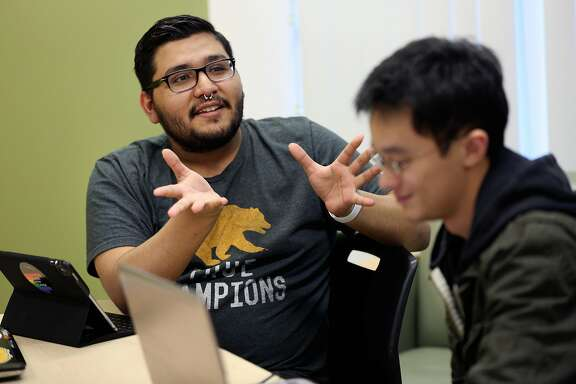 Students No� Ramon and Anthony Khieu, Thursday, Nov. 2, 2017, in San Francisco, Calif. The nonprofit Samaschool is helping job seekers learn about gig economy work.
