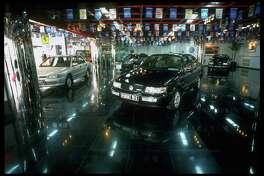 A 1990s-era German Volkswagen Passat is on display at the CIM Auto Mall Co. Ltd. auto showroom.