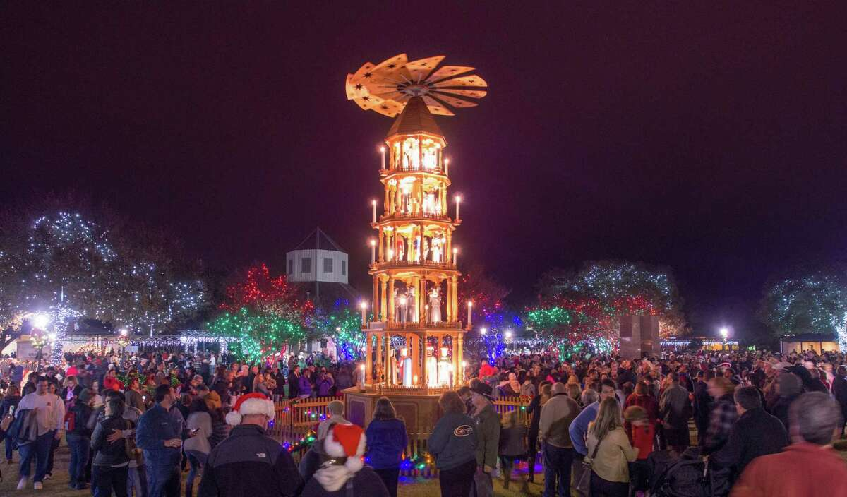 The German Christmas Pyramid joins a Community Christmas tree downtown Fredericksburg.