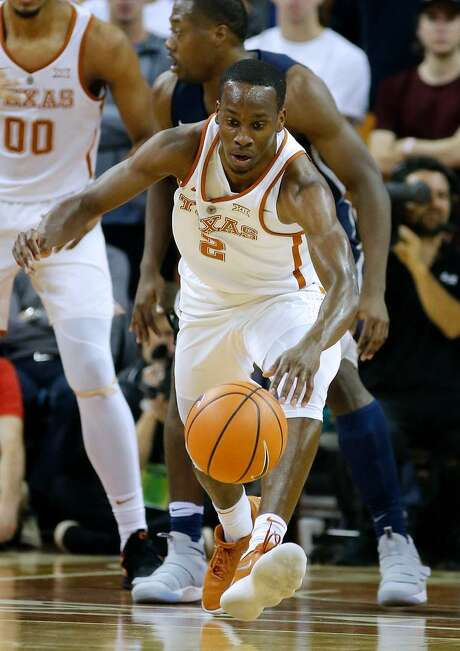 Matt Coleman of the Texas Longhorns reaches for the ball against the New Hampshire Wildcats at the Frank Erwin Center on Nov. 14, 2017 in Austin, Texas. Photo: Chris Covatta / /Getty Images