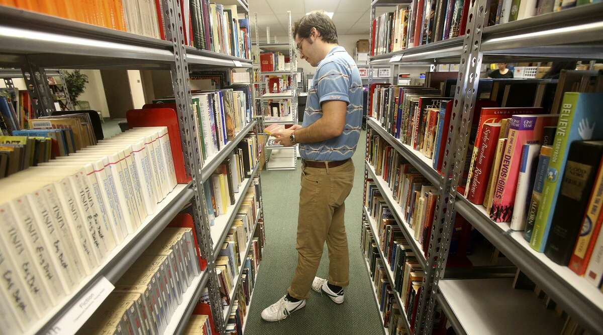 Jack Mitts looks through books at SAReads, a project of Literacy San Antonio.