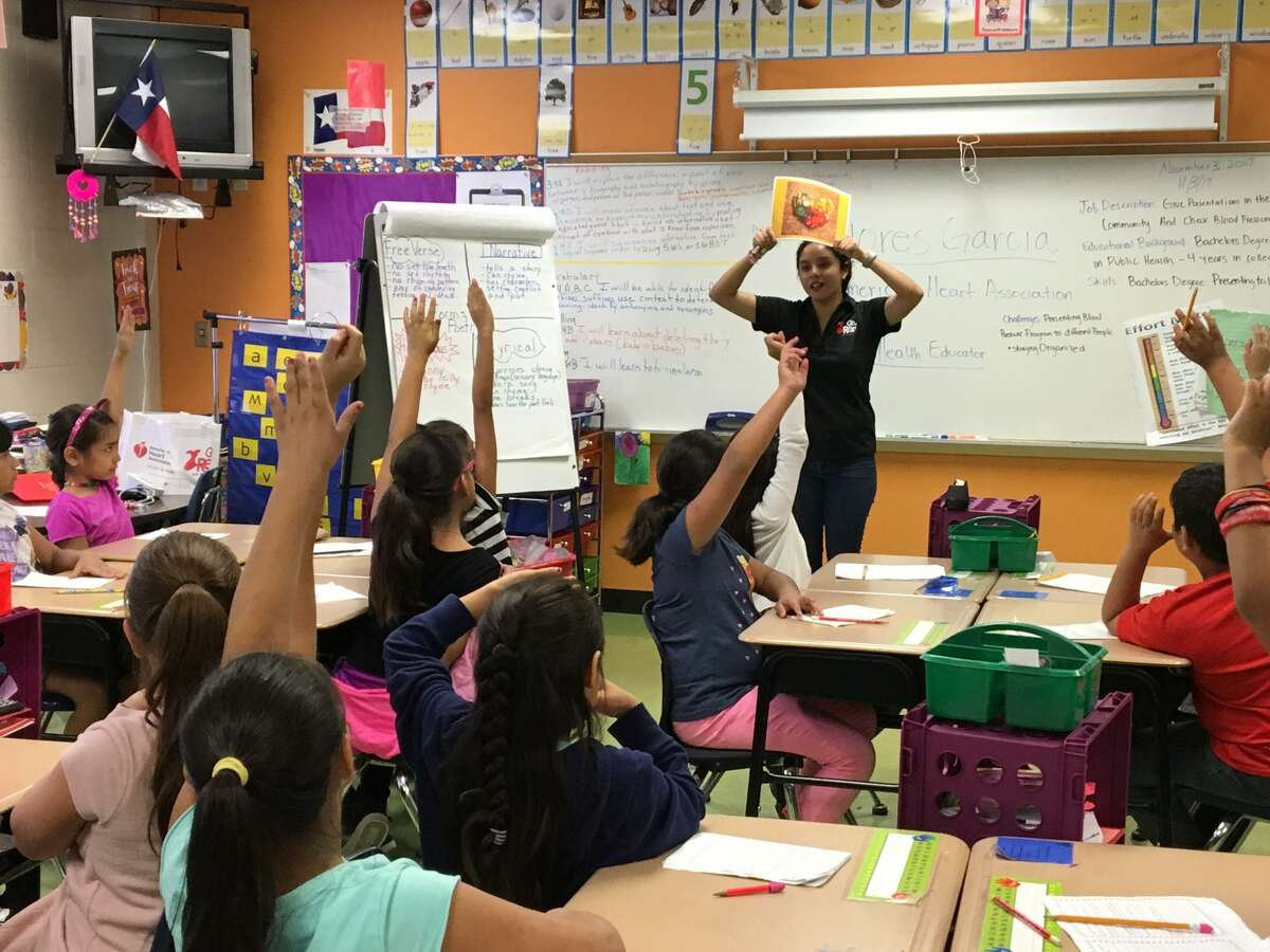 Dolores Garcia, a American Heart Association health strategies associate, gives a talk during an elementary school career day event.