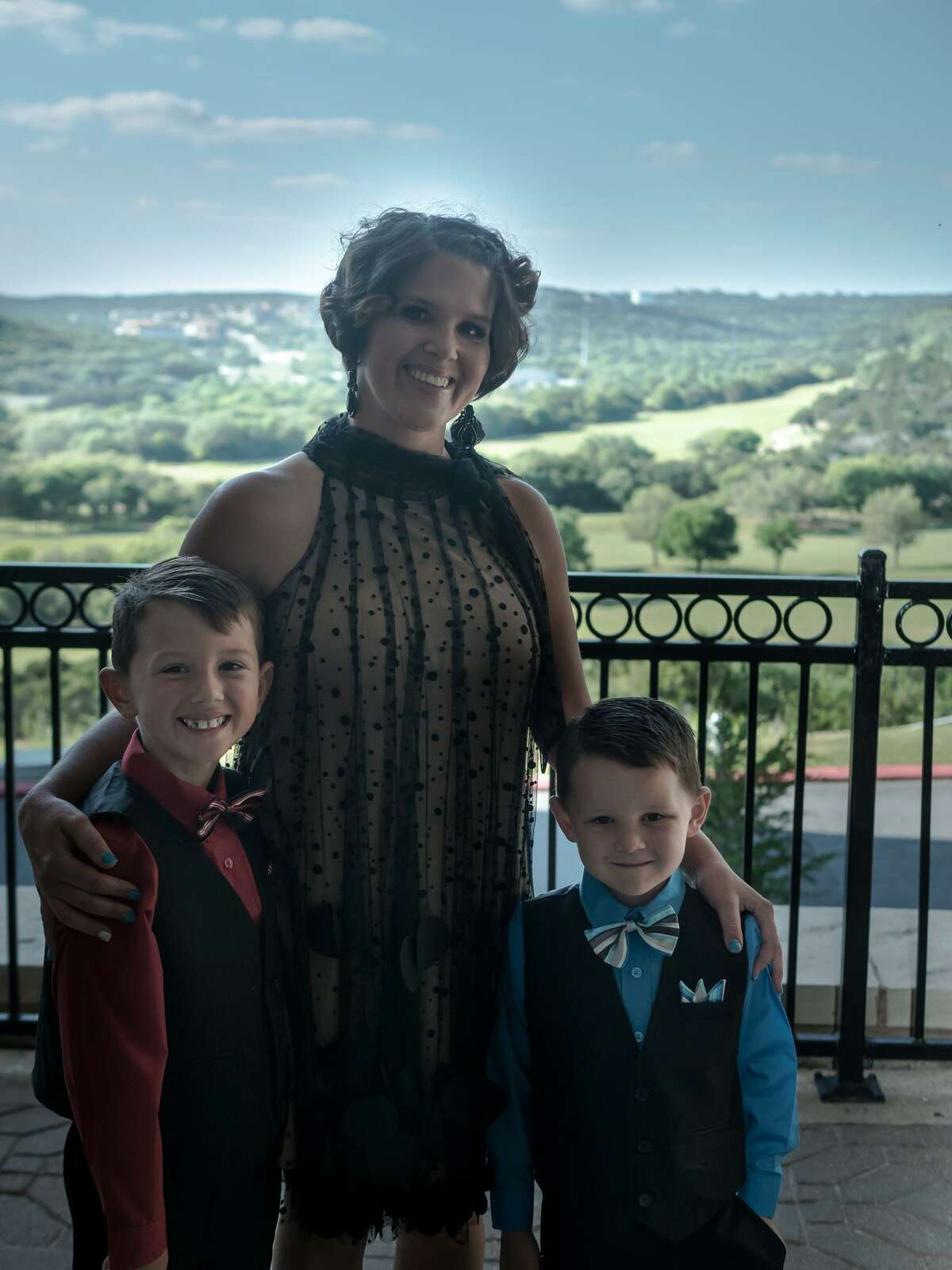 Marsha Mudge is shown with her sons, Tanner and Jackson. Mudge's husband, John Mudge, was a coach at New Braunfels High School. He died a year after having a stroke. The American Heart Association said it has donated CPR equipment to the high school in his honor.