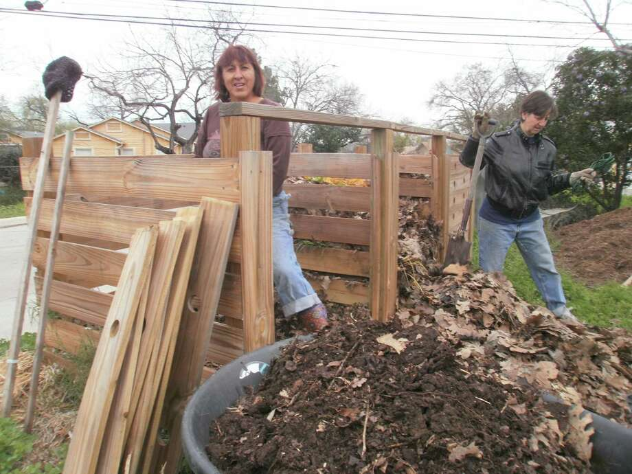 Volunteers Christina Palafox, left, and Bea Caraway, right, work on the compost heap at the Olmos Park Terrace community garden, one of the gardens that was started with grant money through Green Spaces Alliance. Photo: Courtesy Photo