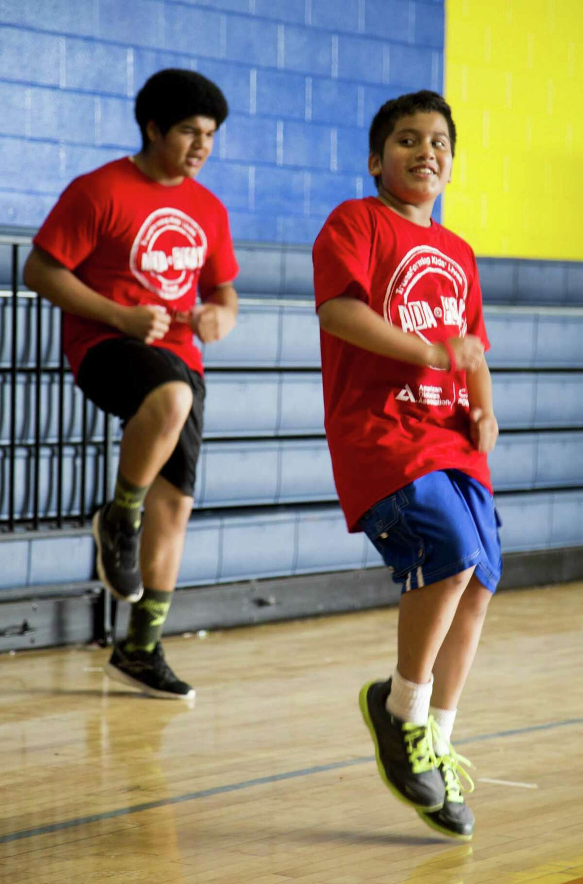 Esteban Gonzalez and David Esquivel participate in physical activities at Camp PowerUp. The American Diabetes Association hosts the camp in San Antonio each summer for children who are at risk of developing Type 2 diabetes.