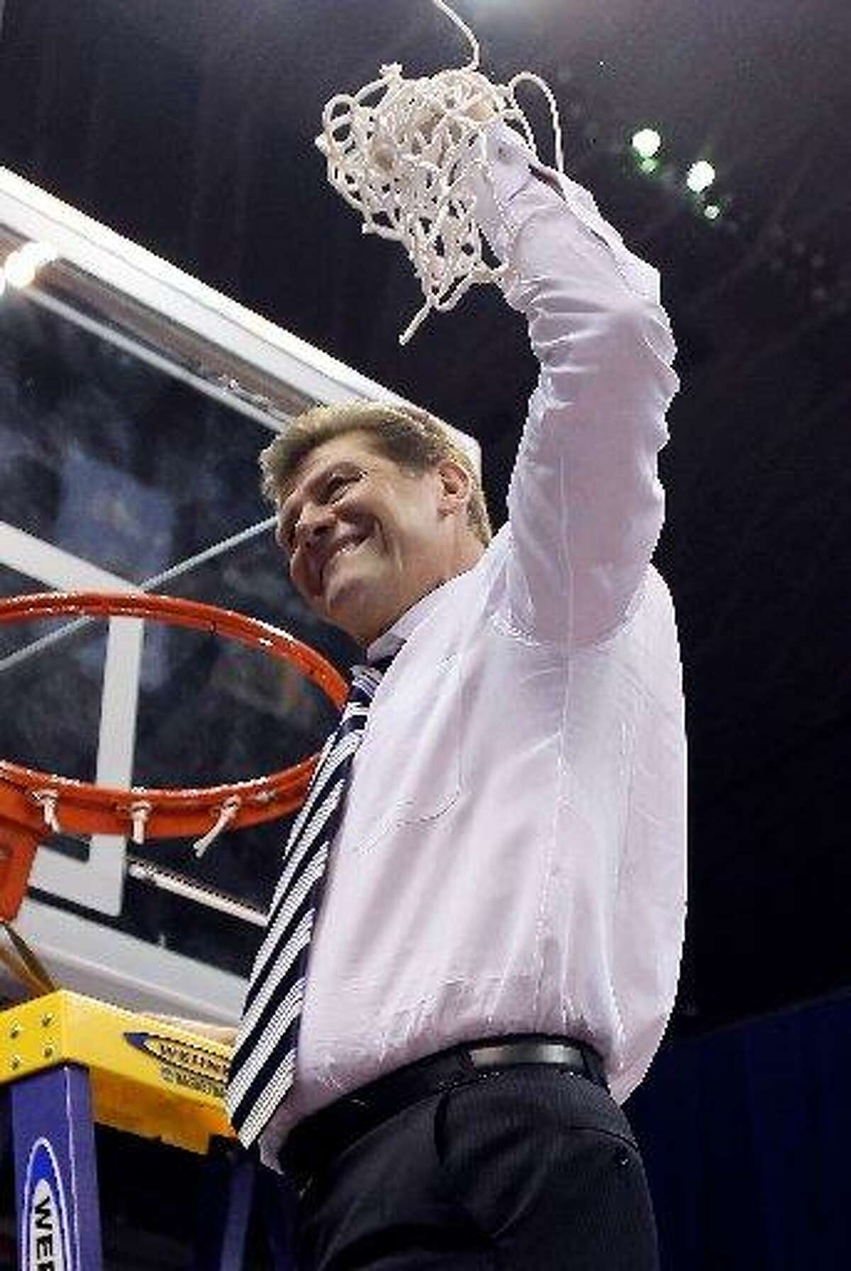 Connecticut Huskies head coach Geno Auriemma celebrates his teams 53-47 win over the Stanford Cardinal by cutting down the net following the the NCAA Women's Final Four Championship game at the Alamodome on April 6, 2010 in San Antonio, Texas.