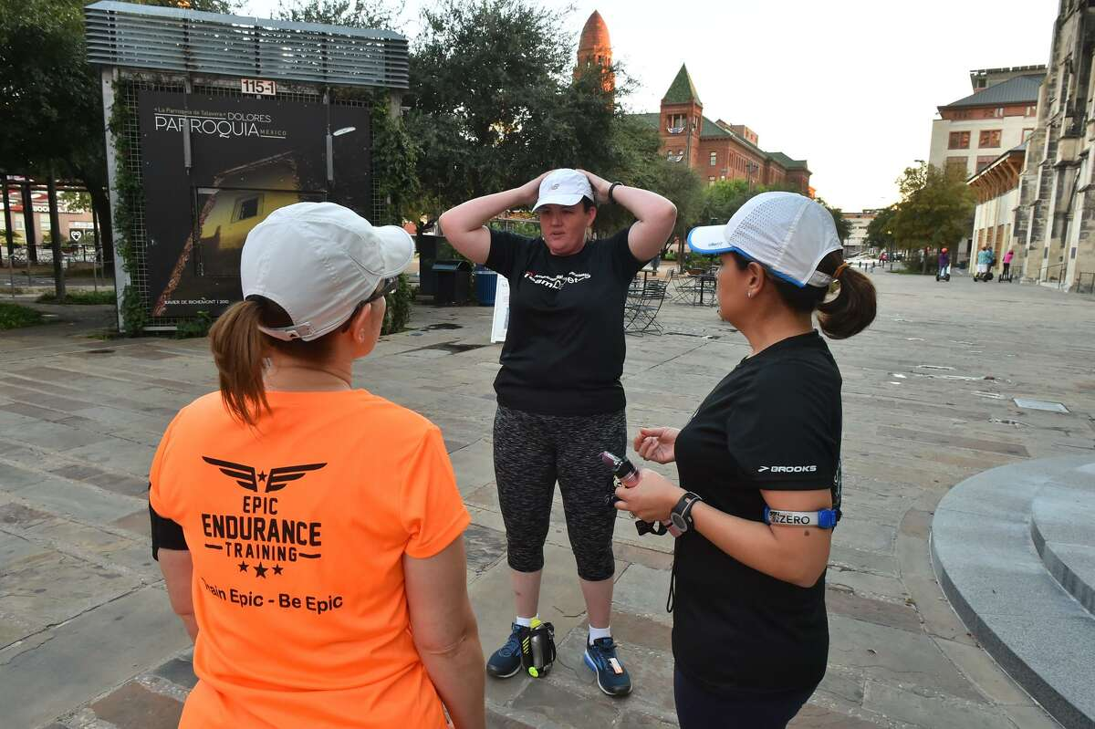 Deirdre Murphy (center) talks with her running maters Krystal Strong (left) and Melinda Cerda prior to a recent downtown run. Murphy is a volunteer with the American Diabetes Association and has Type 2 Diabetes and now is Management Type 1. As a runner, she carries her insulin pump in her pocket.