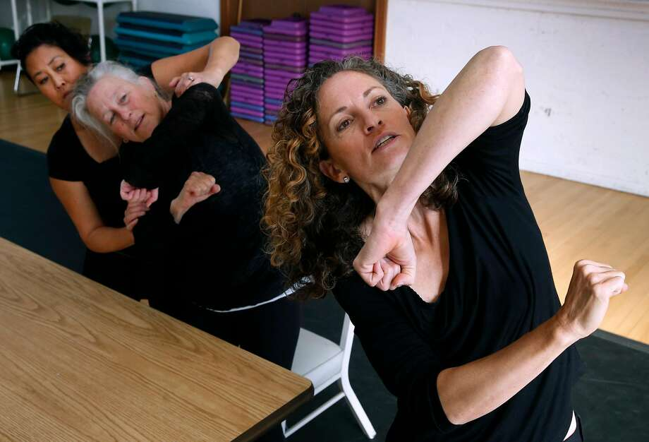 """Sarah Bush (right), choreographer and artistic director of """"Homeward,"""" leads Li-Jue and Lazarus in a rehearsal for the multigenerational dance performance in Berkeley at the Shawl-Anderson Dance Center starting Dec. 9. Photo: Paul Chinn, The Chronicle"""