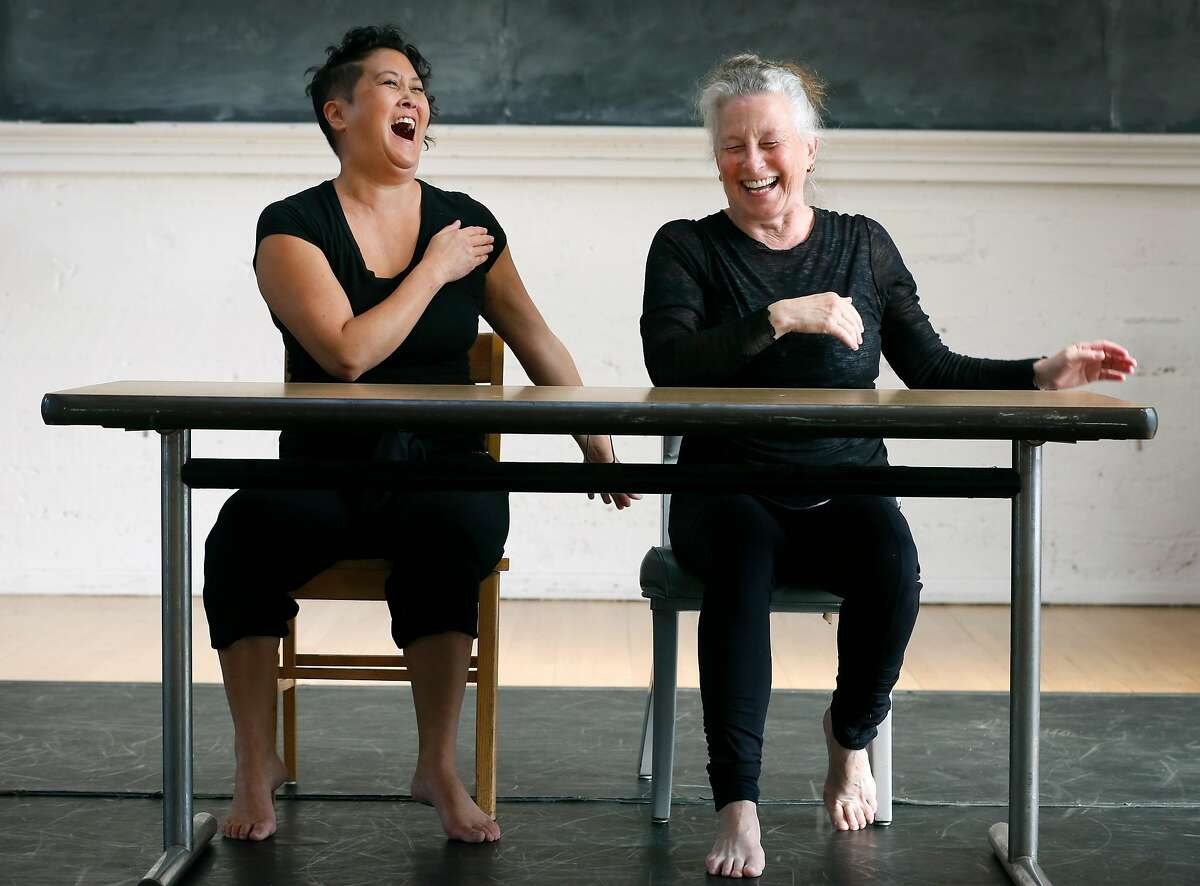 Sue Li Jue and Joan Lazarzus laugh during a rehearsal for Homeward, a dance performance choreographed by artistic director Sarah Bush, in Berkeley, Calif. on Tuesday, Nov. 21, 2017.