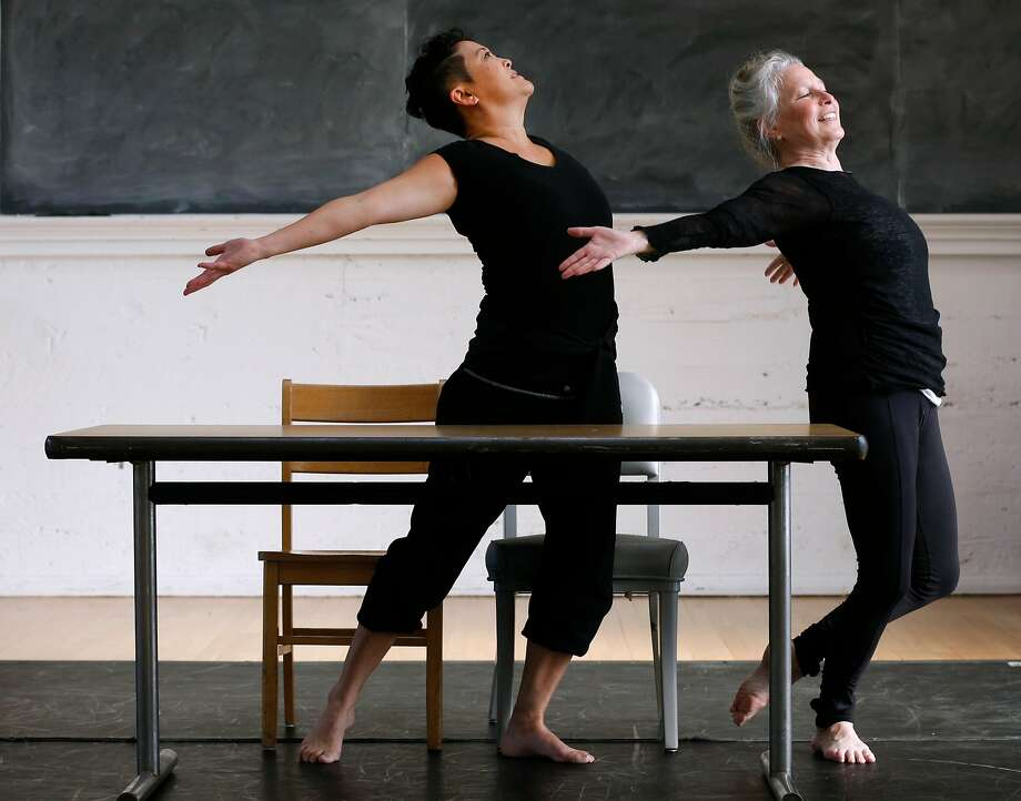 """Sue Li-Jue and Joan Lazarzus rehearse for """"Homeward,"""" a dance choreographed by Artistic Director Sarah Bush for her Dance Project's 10th anniversary show. It's a spin-off of a previous work, but inspired by the recent hurricanes. Photo: Paul Chinn, The Chronicle"""