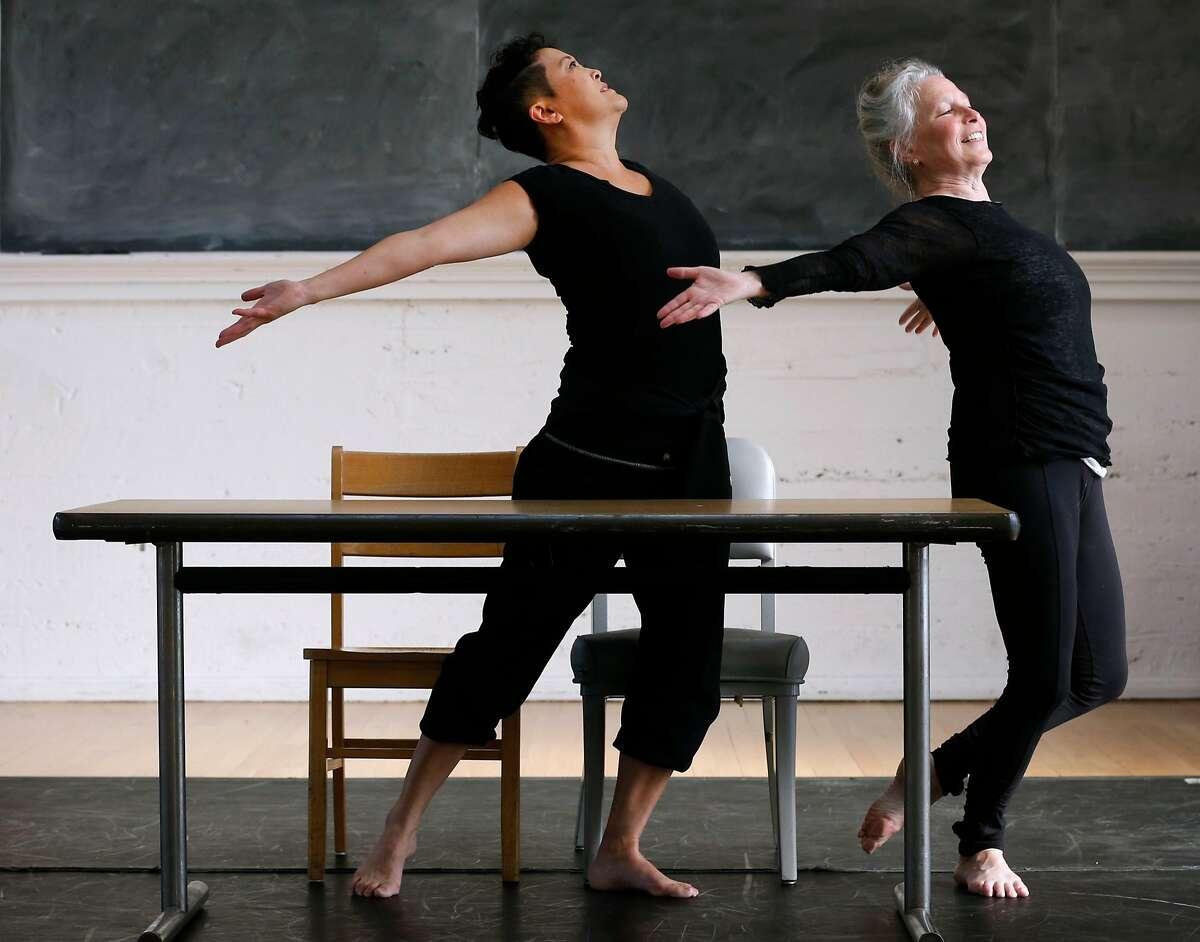 Sue Li Jue and Joan Lazarzus rehearse for Homeward, a dance performance choreographed by artistic director Sarah Bush, in Berkeley, Calif. on Tuesday, Nov. 21, 2017.