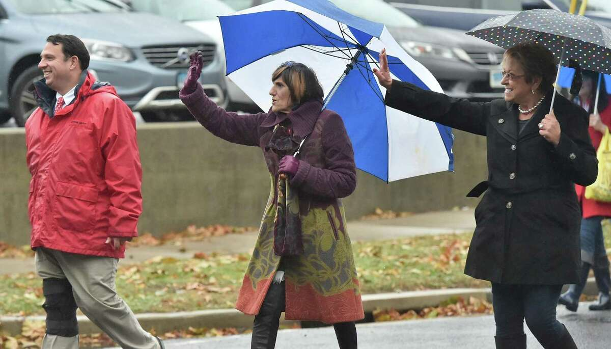 Milford Mayor Ben Blake andRep.RosaDeLauro, D-Conn.brave a rainy day to attend the Milford Veterans Day parade in Milford, Conn. onSunday, November 5, 2017
