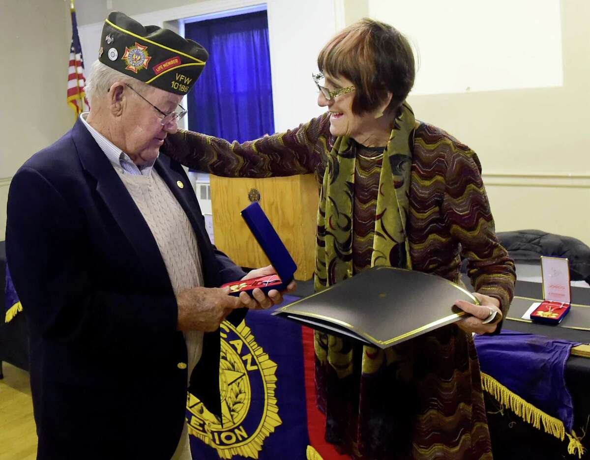 (Peter Hvizdak - New Haven Register) Congresswoman Rosa DeLauro honored Robert Zettergren of Branford who served in the Army in the 40th division 224th Infantry Regiment as a Corporal and served in Korea from 1953 - 1954, and 9 other local Korean War veteransl with the Medal of Gratitude for restoring and preserving the Republic of Korea's freedom and democracy during the Korean War in a ceremony Thursday morning December 21, 2016 at the West Haven American Legion Post 7. The medals, made from recycled barbered wire from the demilitarized zone between South and North Korea were given to her by the South Korean Ambassador Ah Ho-young.