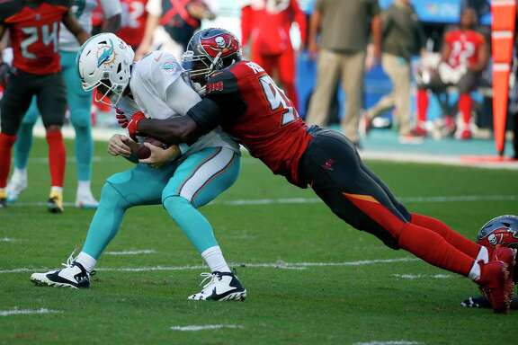 Tampa Bay Buccaneers defensive end Ryan Russell (95) sacks Miami Dolphins quarterback Jay Cutler (6), during the first half of an NFL football game, Sunday, Nov. 19, 2017, in Miami Gardens, Fla. (AP Photo/Wilfredo Lee)