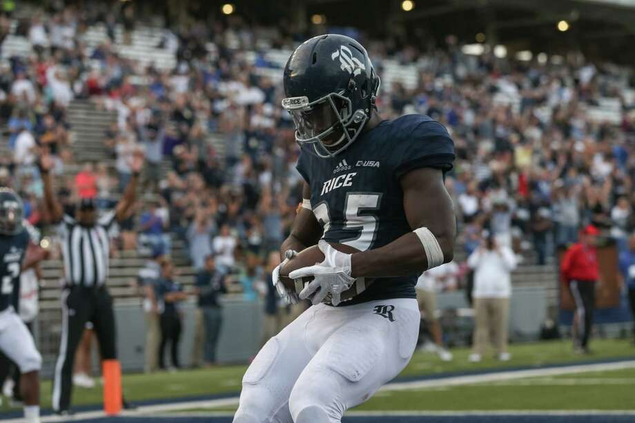 Rice Owls running back Nahshon Ellerbe scores a touchdown in the second half of the college football game between the Southern Miss Golden Eagles and Rice Owls at Rice Stadium in Houston. Photo: Leslie Plaza Johnson, Freelancer / Freelance