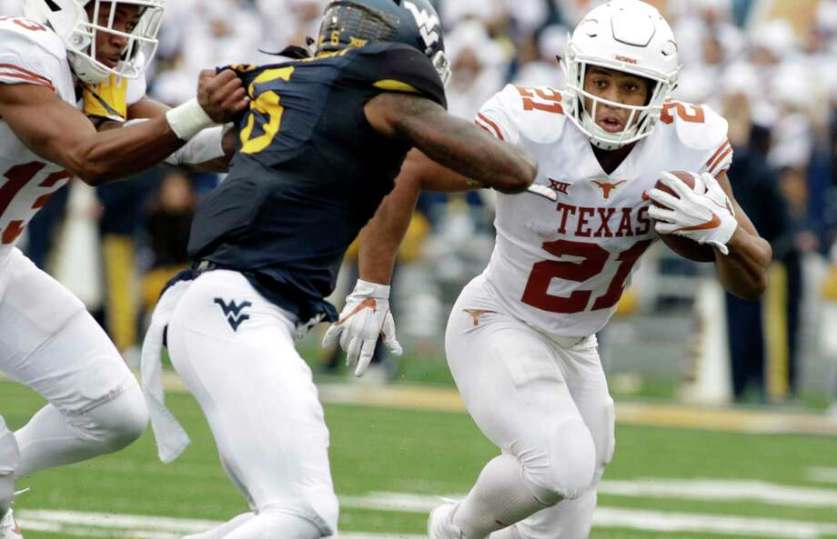 West Virginia safety Dravon Askew-Henry (6) moves to tackle Texas running back Kyle Porter (21) during the second half of an NCAA college football game, Saturday, Nov. 18, 2017, in Morgantown, W.Va. Texas defeated West Virginia 28-14. (AP Photo/Raymond Thompson) Photo: Ray Thompson, FRE / FR171247 AP