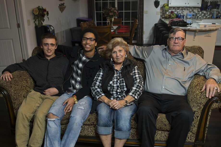 Gail Locke, right, and his wife Rachel Locke, second from right, pose for a photo with their two current foster children, David Hendrix, second from left, and Robby Novak, left, in their home in Clare County on Tuesday, Nov. 21, 2017. The Lockes have served as foster parents through the Midland County Probate Court for 25 years and have been recognized with a Congressional award for their service. (Katy Kildee/kkildee@mdn.net) Photo: (Katy Kildee/kkildee@mdn.net)